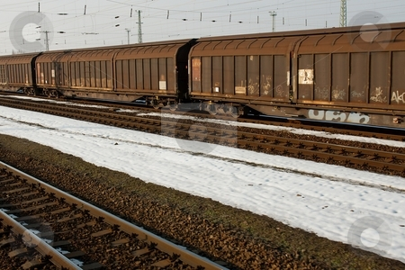 Train stock photo, Old freight train wagons on snowy land by P?