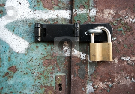 Lock stock photo, Rusty metal door locked with a padlock by P?