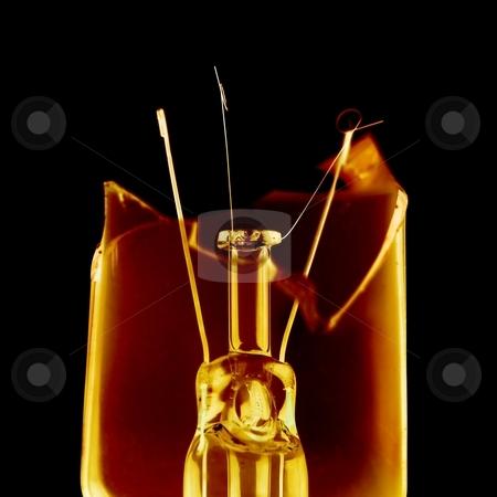 Bulb stock photo, Broken lightbulb glowing on black background by P?