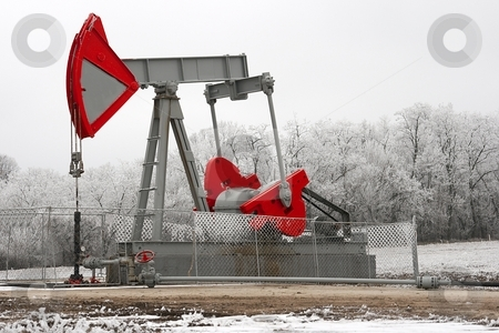 Oil Well stock photo, Oil wall on a pale winter landscape by P?
