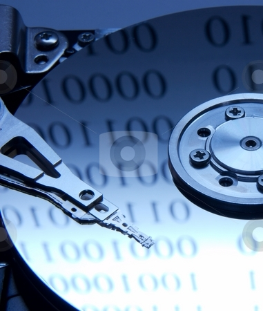 Harddisk stock photo, Internals of harddisk with binary digit reflections by P?