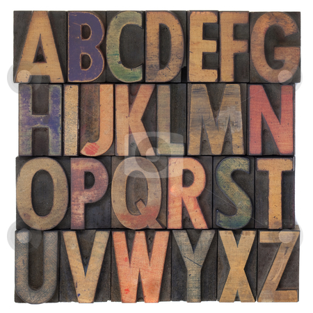 Alphabet in vintage wooden letterpress type stock photo, English alphabet (upper case) in vintage wooden letterpress type, stained by different color ink, flipped horizontally, isolated on white by Marek Uliasz