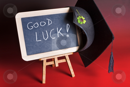 Good luck board stock photo, Graduation cap haning on a blackboard with