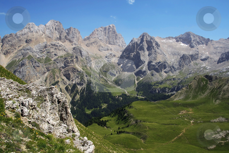 Alpine landscape in summer stock photo, Summer vief of italian dolomites with mount Marmolada on background by ANTONIO SCARPI