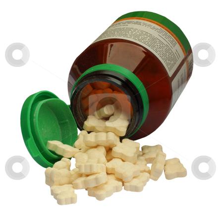 Vitamine pills for children stock photo, Bear shaped vitamine pills for children, isolated on background by Richard Lammerts