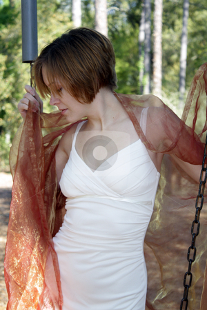 Beautiful Young Woman Outdoors (7) stock photo, A lovely young woman soaks up the morning sun outdoors with some sheer fabric. by Carl Stewart