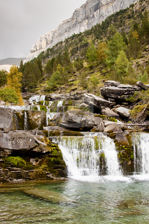 Ordesa park - small cascade stock photo, Small cascades in National Ordesa Park - Pyrenees Spain. Cloudy day. by Tomasz Parys