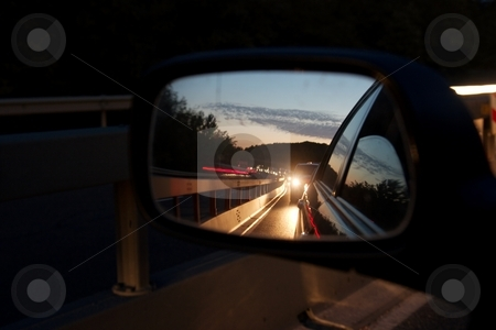 Mirror stock photo, Traffic jam on a highway in the sideview mirror of a car by P?