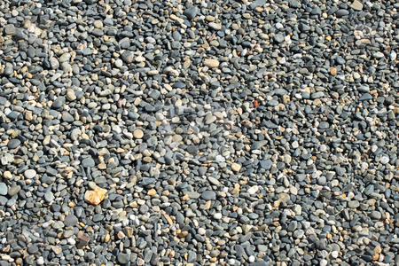 Lots of gray beach stones close up. stock photo, Lots of gray beach stones close up. by Stephen Rees