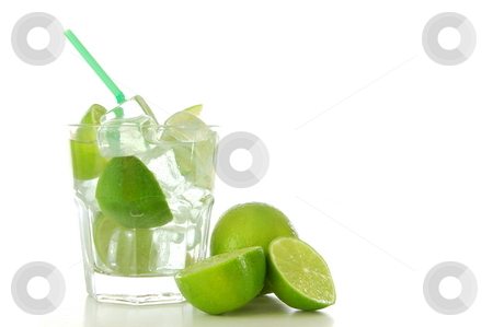 Green cocktail stock photo, Cool green Caipirinha cocktail drink with lime by Gunnar Pippel