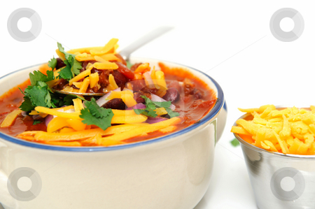 Bowl Of Chili Beans stock photo, Chili and beans in a ceramic bowl with onion, cilantro and cheddar cheese sprinkled on with with sides of each in stainless steel condiment cups. by Lynn Bendickson