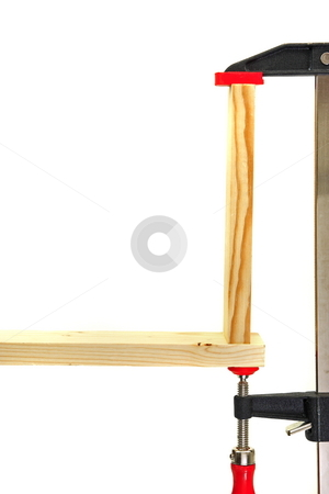 Wood clamp stock photo, Wood working clamp joining vertical and horizontal wood together for gluing by Jack Schiffer