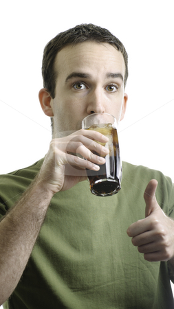 Man Drinking Pop stock photo, A young man drinking a tall glass of pop and giving a thumbs up, isolated against a white background by Richard Nelson