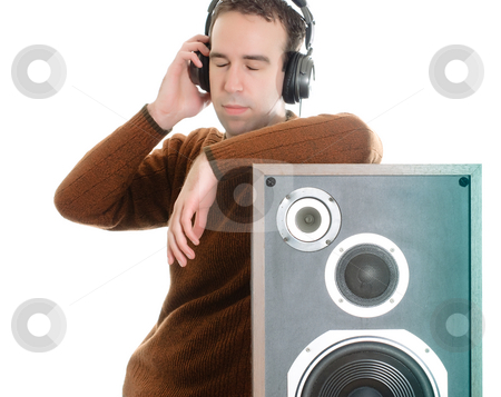 Listening To Music stock photo, A young man listening to some music while resting against a speaker, isolated against a white background by Richard Nelson