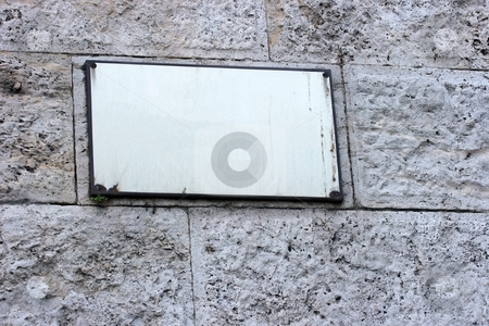 Sign stock photo, Empty signboard on a stone wall. Add your own text! by P?