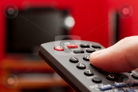 Remote stock photo, Finger on the remote control of a TV by P?