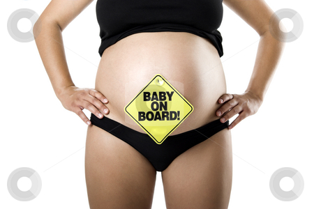 Baby on Board stock photo, Nine Months Pregnant with a signal of  Baby on board on her tummy by ikostudio
