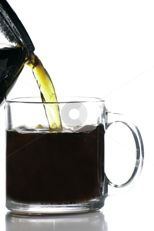 Morning Coffee stock photo, A morning coffee is being poured into a clear glass coffee cup, shot against a white background by Richard Nelson
