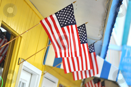 Store Front with American Flags stock photo, Colorful store front with three American flags flying. by Danny Hooks