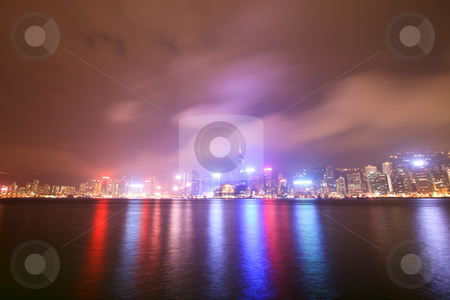 Hong Kong By Night stock photo, Hong Kong City Lights By Night Reflecting On Water by Nick Fingerhut
