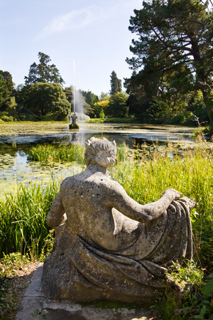 Powerscourt gardens in Ireland stock photo, Magnificient gardens at Powerscourt in Ireland with view over the Dolphin pond, Neptune statue and water fountain. by Andreea Chiper