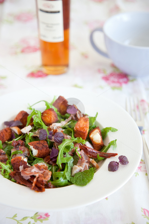 Delicious salad stock photo, Delicious salad with haloumi, bacon and rocket by Simone Van den Berg