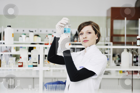 Young woman in lab  stock photo, Science chemistry classes with young student woman in labaratory by Benis Arapovic