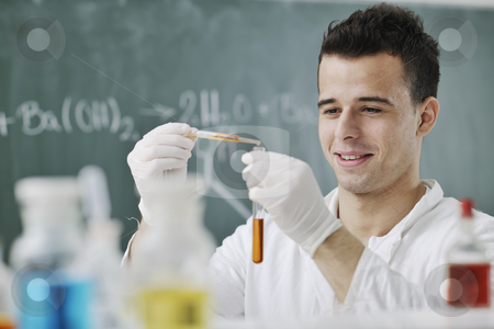 Young scientist in lab stock photo, Young man scientist in chemistry bright lab by Benis Arapovic