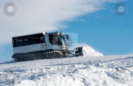Ski resort stock photo, Ski slope with a white ratrak doing track maintenance by P?