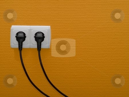 Socket stock photo, Two electric outlets on orange wall by P?