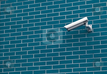 Security camera stock photo, Security camera on the brick wall of a building by P?