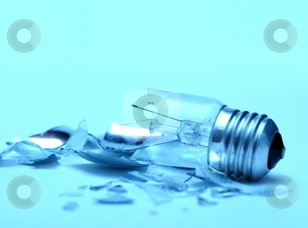 Bulb stock photo, Broken lightbulb and it's fragments around on blue background by P?
