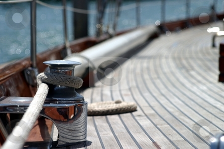 Sail boat rope stock photo, Sail boat close up of a rope on deck by Henrik Lehnerer