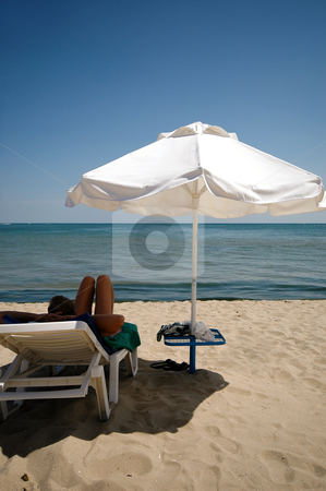At the beach stock photo, Man, umbrella and sunbed. Taken on a sunny day. by Lars Christensen