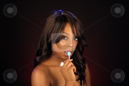Beautiful BlackWoman, Headshot (18) stock photo, An extraordinarily beautiful young black woman with candy. by Carl Stewart
