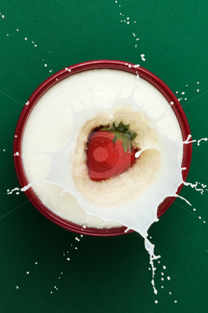 Strawberry Milk stock photo, Strawberry dropped into bowl of milk, creating a splash sculpture by Viv Van der Holst
