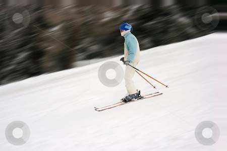 Ski stock photo, Female skier with motion blur by P?
