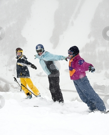 Skiers stock photo, Happy skiers standing in the falling snow by P?