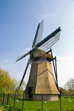 Dutch mill stock photo, Dutch mill with fence on sunny april afternoon by Colette Planken-Kooij