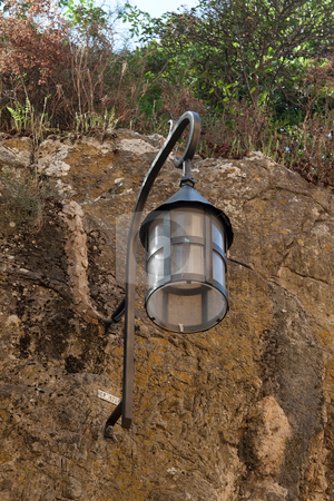 Old Lantern stock photo, A old looking street light attached to a wall by Kevin Tietz