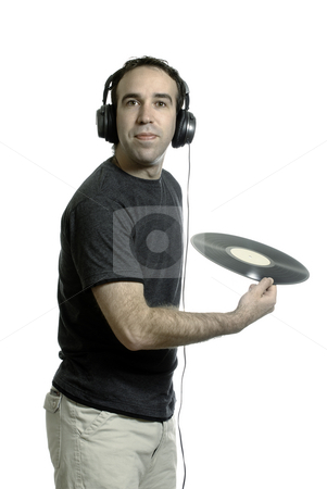Garbage Technology stock photo, A young man wearing a set of headphones about to throw away an old LP record, isolated against a white background by Richard Nelson