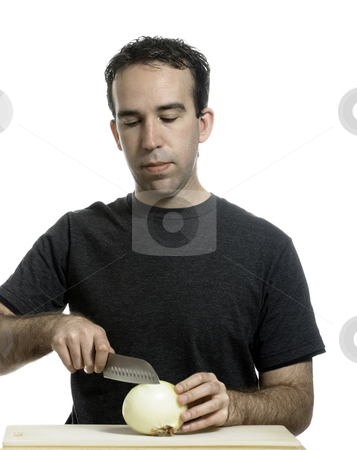 Man Cutting Onion stock photo, A young man cutting an onion with a sharp knife, isolated against a white background by Richard Nelson