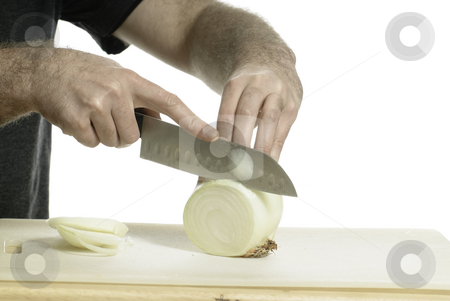Cutting Onion stock photo, Cutting an onion with a sharp knife on a cutting board by Richard Nelson