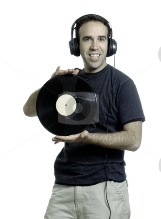Record Man stock photo, A young man wearing a set of headphones and holding an old LP record, isolated against a white background by Richard Nelson