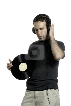 LP Record stock photo, A young man wearing a set of headphones and holding an old LP record, isolated against a white background by Richard Nelson