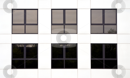 Office block stock photo, Six windows in an office block of a white office by Paul Phillips