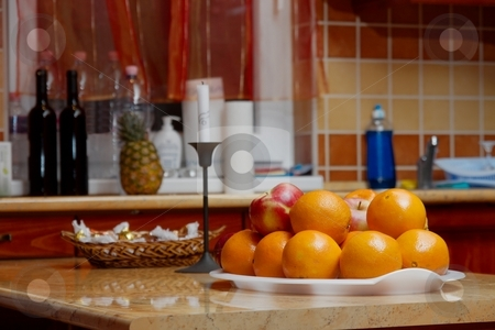 Kitchen stock photo, Kitchen table with a pile of oranges by P?