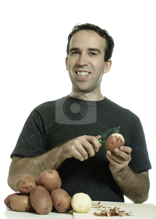 Kitchen Prep Work stock photo, Kitchen prep work being done by a guy peeling potatoes, isolated against a white background by Richard Nelson