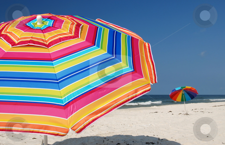 Beach Umbrellas stock photo, Beach umbrellas on white sand beach. by Danny Hooks