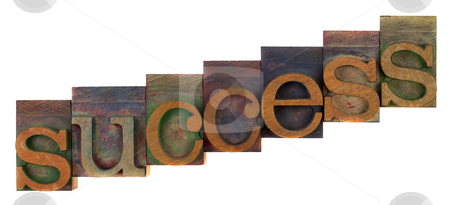 Success concept - letterpress wooden type stock photo, Success or growth concept - old letterpress wooden type blocks, stained by colorful inks,  isolated on white by Marek Uliasz